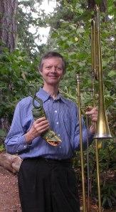 Phil Neuman holding the tartold and contrabass sackbutt