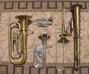 Some of the instruments played by the Pioneer Brass Band: Berliner valve tuba c. 1870, cornet, tenor horn, trombone c. 1890, ophicleide c. 1840