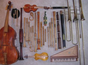 Some of the instruments played by the Oregon Renaissance Band. Top row, left to right: treble viol, alto curtal; 2nd row: bagpipe, gourd rattle, tartold, tenor alt rackett, tenor sackbutt, bass sackbutt, contrabass sackbutt; 3rd row: violone, tenor shawm, alto shawm, 2 schreierpfeiffen, 2 krummhorns, bass douçaine, 4 recorders, 3 cornamusen, bass Praetorius schreierpfeif, bass rackett, bass curtal; 4th row: great bass rackett; 5th row: viola da braccio, spinettino
