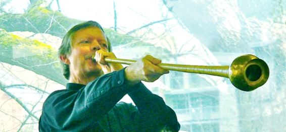 Phil Neuman demonstrates playing an ancient Greek horn.